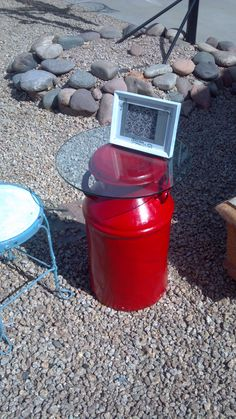 vintage milk can converted to a sassy fire engine red side table