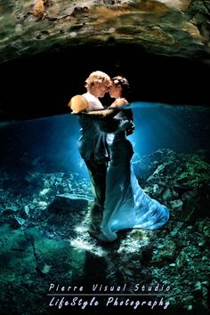 Would love to do it completely under. Maybe kissing or holding hands. I would buy a cheap dress for that or a swimsuit and my veil though.