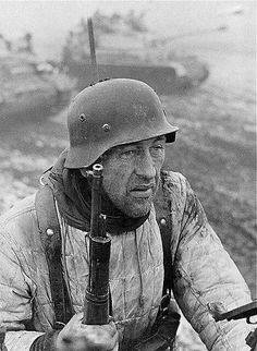 A Panzergrenadier with a tired look moving again to meet the enemy and defend his Fatherland.