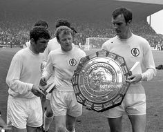 ,2nd August 1969. Johnny Giles, Billy Bremner, and Paul Madeley parade the Charity Shield around Elland Road following victory over Manchester City.