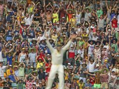 The Gabba crowd celebrates after Steve Smith takes a catch to dismiss Ian Bell during day two of the first Ashes Test match between Australi...