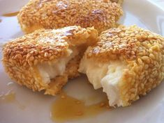 Fried Feta with Sesame Seeds & Honey - This fried feta is a delicious dish that has it's origins in Cretan cuisine, where one can find lots of recipes that combine salty cheese with sweet, or sour-sweet honey sauces and the nutty flavour of slightly toasted sesame seeds.