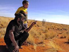 Walala Tjapaltjarri, one of the Pintupi Nine, with his son Josiah in 2007. Picture: Justin Sanson