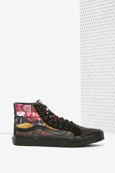 Get ready to kick it in the super flattering Sk8-Hi Slim Sneakers by Vans.