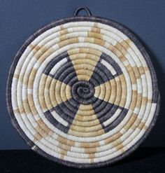 4 petal coiled Hopi basket.  These petals signal thoughts of a propeller plane's blades. $70.00