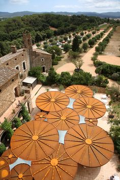 Castell d'Emporda by Concrete. Surrounding the courtyard is the fourteenth century castle, which was converted into a boutique hotel back in Dutch architects Concrete designed flattened parasols of rusted steel to shelter the terraced restaurant out Urban Landscape, Landscape Design, Garden Design, Architecture Design, Landscape Architecture, Landscape Structure, Parasols, Shade Structure, Concrete Design