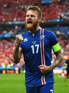 Aron Gunnarsson of Iceland celebrates his team's victory in the UEFA EURO 2016 Group F match between Iceland and Austria at Stade de France on June 22, 2016 in Paris, France.