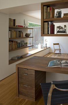  Dwell. Shelving blending into bench/ box seat under window...lovely and simple.