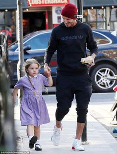 Cute: Harper's long brown hair was kept tidy in two long plaits as she skipped beside her ...