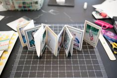 Mini accordion-style photo album, with very clear tutorial.