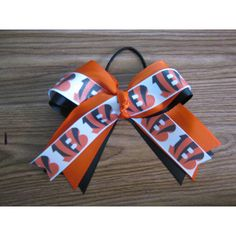 Cincinnati Bengals Logo Hair Bow (11 AUD) ❤ liked on Polyvore featuring accessories, hair accessories, hair bow, ribbon hair bows and hair bow accessories