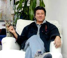 Steve Perry and his cat..first time I envied being a cat.  Meee--ow!