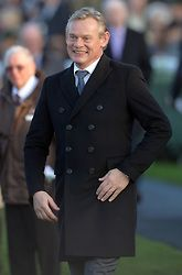 Image ©Licensed to i-Images Picture Agency. 29/11/2014. Newbury, United Kingdom. <br /> <br /> Martin Clunes walks in the paddock before the main event at the Hennessy Gold Cup at Newbury Racecourse, Newbury, UK.<br /> <br /> Picture by Ben Stevens / i-Images