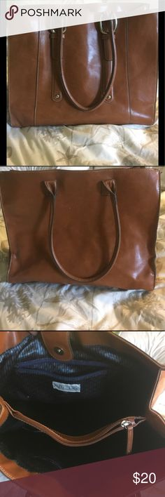 Kelly and Katie brown/tan simulated leather tote Kelly and Katie brown/tan simulated leather tote. About 5'' deep with multiple pockets for everything. Approx 14x10. Large enough to fit a 13'' iPad Pro for on the go, or similar sized device. Few blemishes/scratches on the back, see pic 2. Interior is perfect. Kelly & Katie Bags Totes