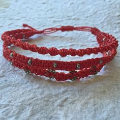 """red """"tun"""" handmade wrap bracelet 3 in 1 boho Triple wrapped red macrame boho bracelet. 100% waxed polyester thread with metal beads. Handmade by skilled artisans in Guatemala. Each bracelet is made with care and is one of a kind. Ketzali Jewelry Bracelets"""