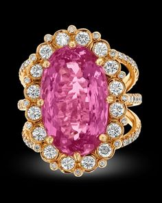 Imperial Topaz Ring by Erica Courtney, 8.75 Carats~ A stunning Imperial topaz weighing approximately 8.75 carats is the star of this eye-catching ring by jewelry designer Erica Courtney. The delicate pink hues of the coveted gemstones are perfectly complemented by white diamonds totaling approximately 1.50 carats in an 18K yellow gold setting. ~M.S. Rau Imperial Topaz, Rare Gemstones, Jewelry Designer, Alexandrite, White Diamonds, Topaz Ring, Peridot, Garnet, Delicate