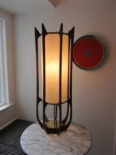 """""""Jail House Rock"""": teak curved rods, original shade, pull chain. 38.5"""" H."""