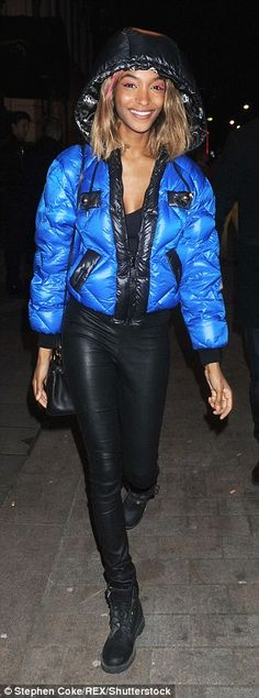 Keeping cosy: She donned an electric blue padded jacket with a hood from Moschino...