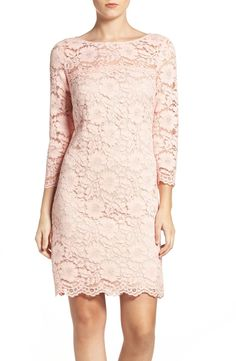 Sheer shoulders and sleeves elevate the romance of this lacy party frock in pale pink.