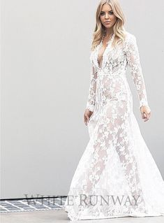 Ashley Lace Dress. This Mariana Hardwick Lace Dress makes a beautiful, luxury lace wedding dress. Features delicate lace scalloping along the hem and neckline. Can be worn with a long slip or short slip as shown. Model pictured wears our short white slip and short nude slip.