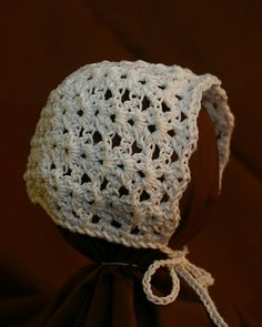 Crochet heirloom bonnet; works up very quickly and is easy to construct.
