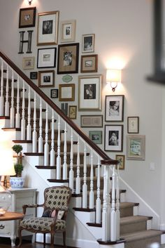Picture collage - love the idea of mismatched photo frames up the stairs
