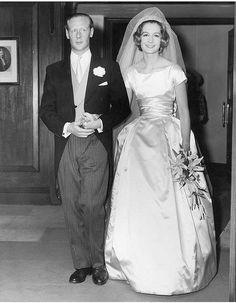 a full length photo of Sandra Paul and Robin Douglas-Home on their wedding day.