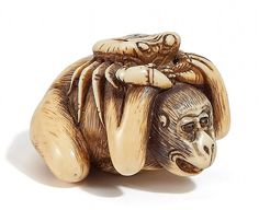 Netsuke MONKEY WITH CRAB. SPERM-WHALE TOOTH. 18th century.