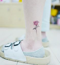 Small rose tattoo on ankle by Banul
