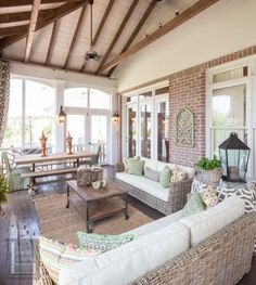Two story double porch with outdoor fireplace, travertine patio, and AZEK deck - contemporary - porch - nashville - The Porch Company