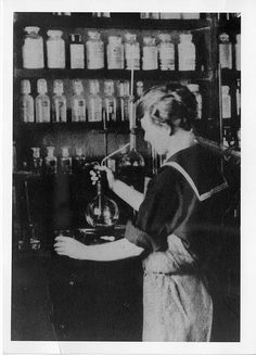 Margaret D. Foster (1895-1970) working in the lab in 1919. Foster was the first woman chemist to work for the United States Geological Survey, starting in 1918, just three days after receiving her A.B. from Illinois College. Foster's studies primarily focused on the analysis of natural waters. Her work on the Manhattan Project resulted in two new quantitative methods of analysis, one for uranium and one for thorium