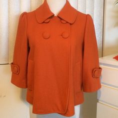 Cutest orange coat!! The cutest vintage style coat. One quarter sleeves with button back detail. Gently used and perfect for the cold weather! Forever 21 Jackets & Coats