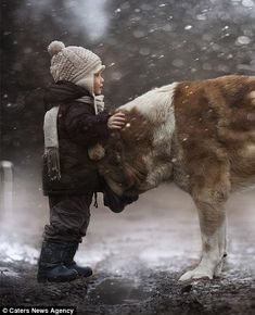 Evocative: Mrs Shumilova (left) likes to use different light conditions - from street lights, fog, smoke, rain and snow - to 'give visual and emotional depth to the image'  Read more: http://www.dailymail.co.uk/news/article-2539802/The-child-animal-whisperers-Mothers-intimate-photographs-capture-sons-special-bond-dogs-ducks-rabbits.html#ixzz2qTqWEtTn  Follow us: @MailOnline on Twitter | DailyMail on Facebook