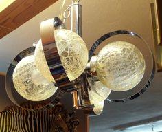 Four lobe chrome and crackle glass pendant light fixture.
