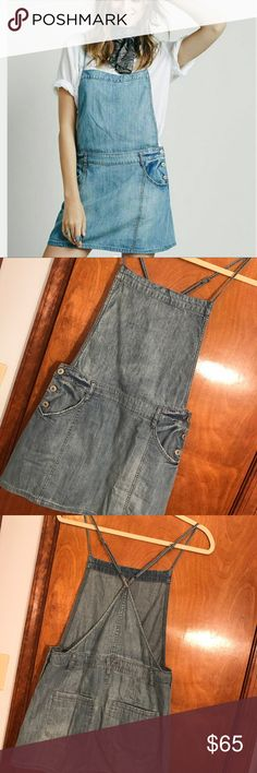 Free people size 4 jean dress jumper ! Free people, size 4, jean material, buttons on sides, spaghetti strapped, so so cute just doesn't fit me :( PERFECT CONDITION !! Jumper , dress , one piece! Free People Dresses Mini