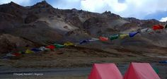 Tents, flags and mountains