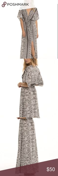 FINAL SALE!! Black Mara Caftan Maxi Dress A deep v neckline adds a cheeky feminine touch to this flowing, casual caftan dress. The high leg slit shows off your calf and let's you move freely. Color looks slightly navy blue in person.    Brand is Elan not Free people- just need visibility Free People Dresses Maxi