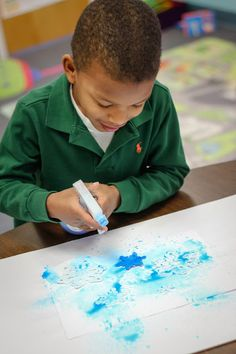 Spray (Bottle) Painting Snowflakes! A great activity to build fine motor control and hand strength