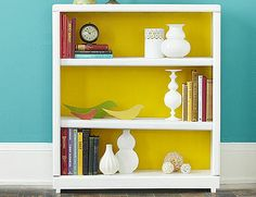 simple way to revamp a bookshelf and make a statement in any room !