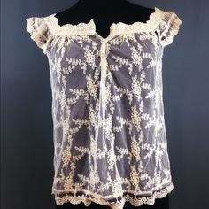 """⛱Labor Day Sale⛱ Cream Sheer Lace Top Lace, man. Probably my favorite summer fabric. This is a cream (I prefer """"antique white"""") lace top - lovely scalloped hem, 3 buttons at bust, and can be worn on shoulder or off (I love my linebacker shoulders so all off-shoulder all the time!), with a cami underneath or just a bra or bikini top you want to show off more!   Brand:  Pinky, size S  MEASUREMENTS (flat, inside out) Length: 24"""" shoulder to hem Bust: 36"""" Waist: 39""""   #lace #laceshirt #cream…"""
