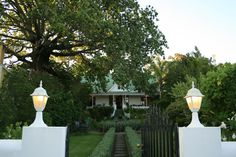 Experience the charm and comfort of Cypress Cottage, one of the oldest homesteads in the historic village of Swellendam. Sa Tourism, Horse Stables, Lush Garden, Homesteads, Countries Of The World, Contemporary Furniture, South Africa, Cape, Old Things