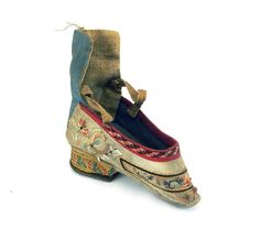 Chinese foot-bound shoe with a cream silk background along the sides, and a blue…