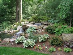 Natural pond with multiple waterfalls. Pond was located along wood edge to make it very natural looking. Southern Landscaping, Pond Landscaping, Landscaping With Rocks, Rustic Landscaping, Backyard Water Feature, Ponds Backyard, Garden Ponds, Pond Waterfall, Natural Pond
