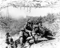 A gun crew of the 88th Field Artillery, ROK Army, fires a 155-mm howitzer at Communist positions during action against the Chinese Communist forces in the Shanghi Heights Area, west of Chorwon.  30 October 1952