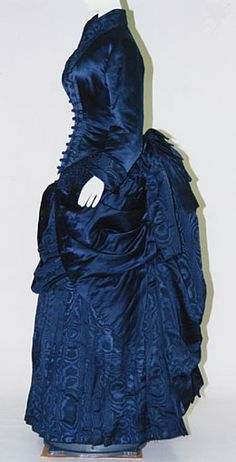Walking dress, ca. 1884. It seems that this is another picture of the blue dress from 1884 that is just a few pins away. The lighter color fooled me into thinking it was different.. ;)