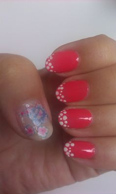 Washi tape nail design. The thumb with flowers from washi tape on a clear base. The others fingers are decorated with white dot french on the pink base.