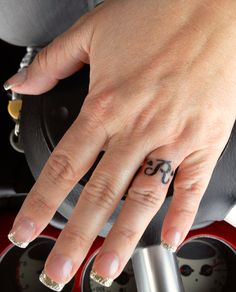 """Hubby's initial with hearts wedding """"ring"""" tattoo"""