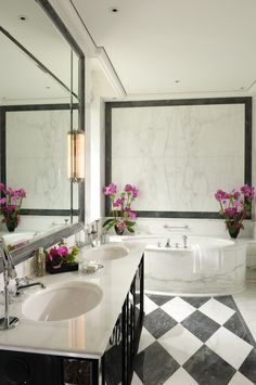Luxurious white marble suite bathroom with round bath tub, checked marble floor at the 5 Star Hotel Baur au Lac in Zurich Switzerland. Member of Leading Hotels Of The World