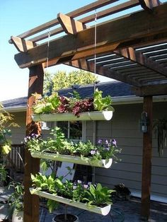 Hanging gutters used as planters. Such a cute idea and looks awesome