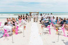 Beach Wedding Ceremony - Kate Spade Inspired Beach Wedding at the Pelican Beach Clubhouse -  Satellite Beach, FL - Photo: Lisa Marshall Photography - click pin for more - www.orangeblossombride.comOrange Blossom Bride